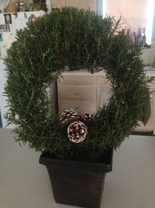 When I sell a story, my partner buys me a potted plant. This is rosemary in the shape of a wreath. :D