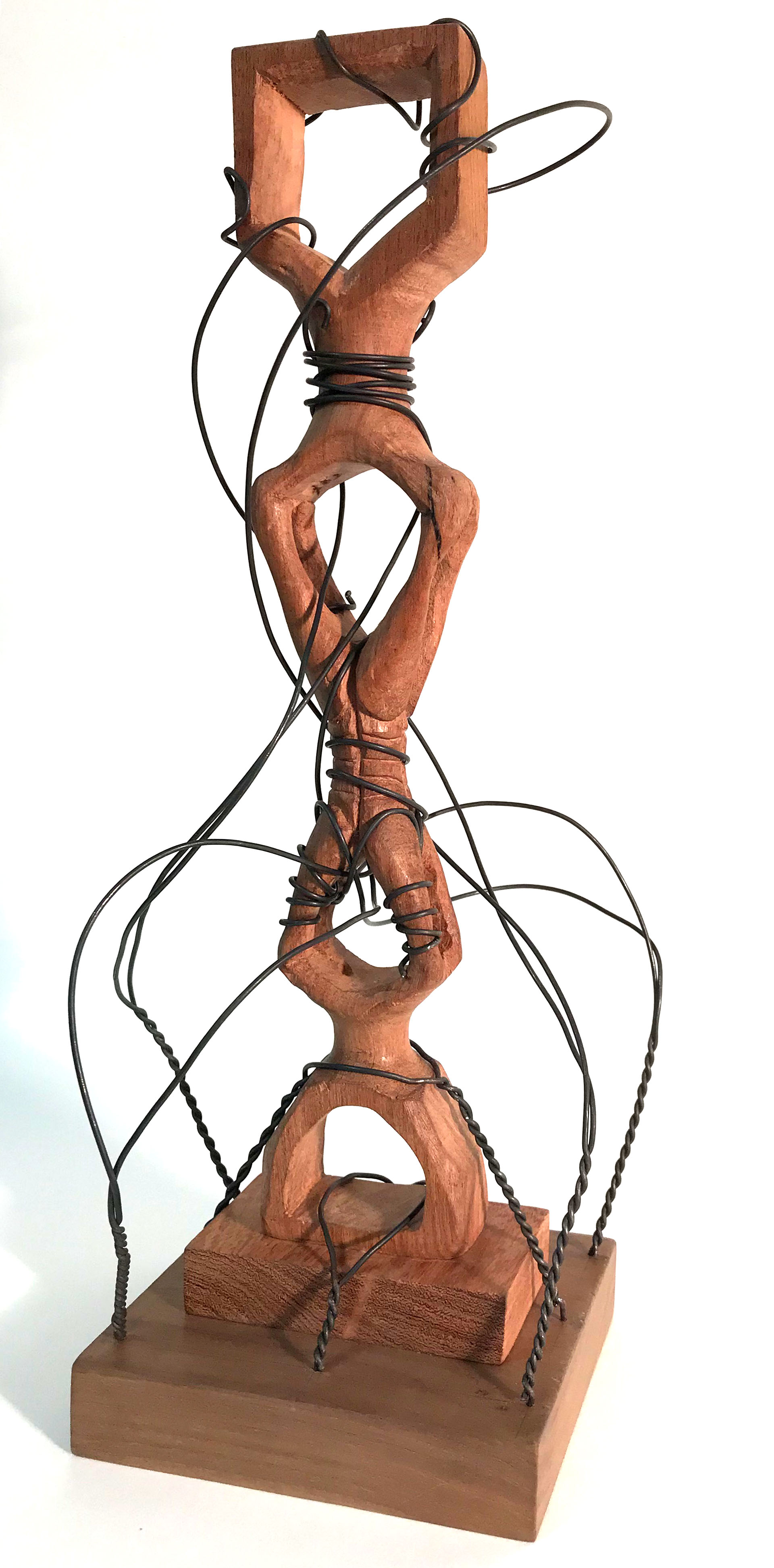 Art: wooden sculpture with wires stretching over it
